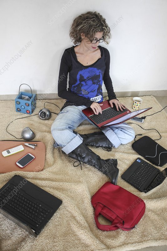 Young stylish woman works from home