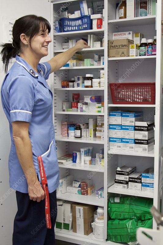 Cancer nurse retrieving drugs