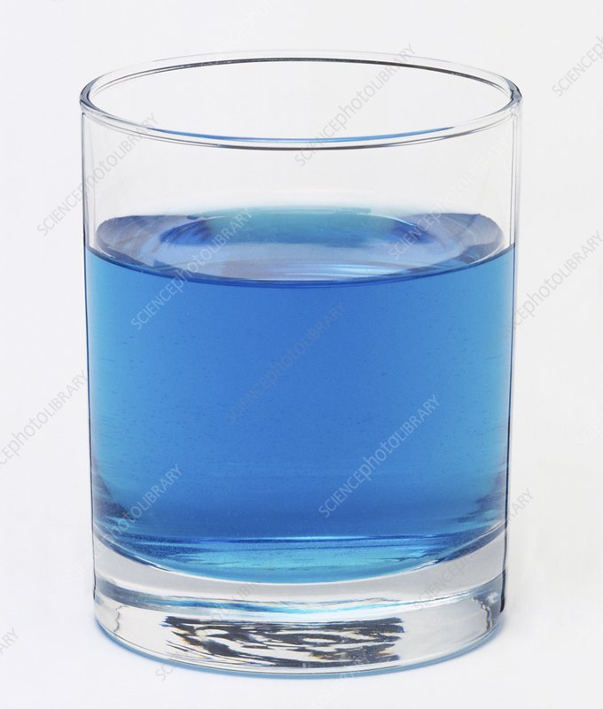 Glass filled with a blue liquid
