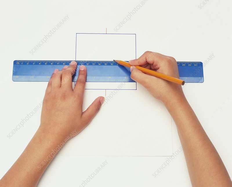 Hands using pencil and ruler