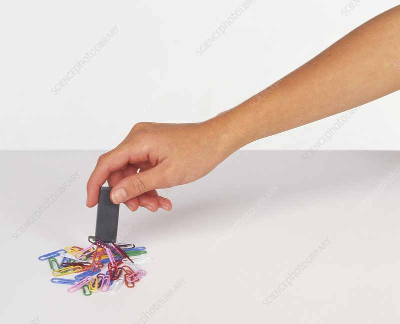 Hand holding a magnet