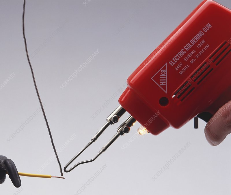 Electrical soldering iron with solder