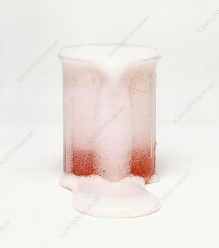 Carbonated drink overflowing from beaker