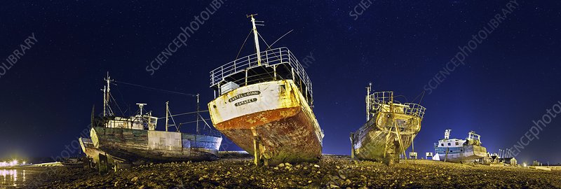 Beached wrecks at night