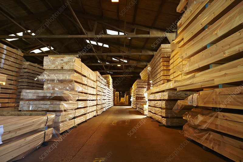 Stacks of timber planks in large timber s