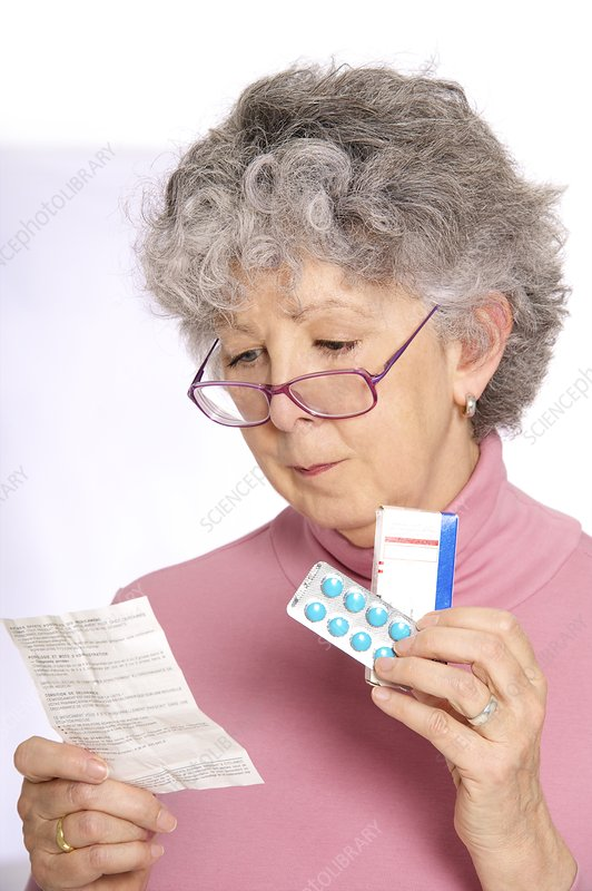 Woman reading medicine instructions