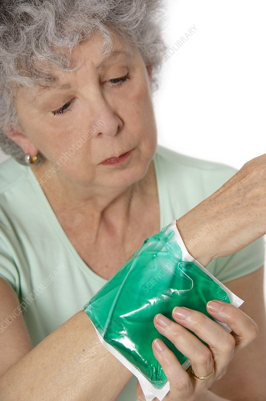 Patient applying a thermal pack