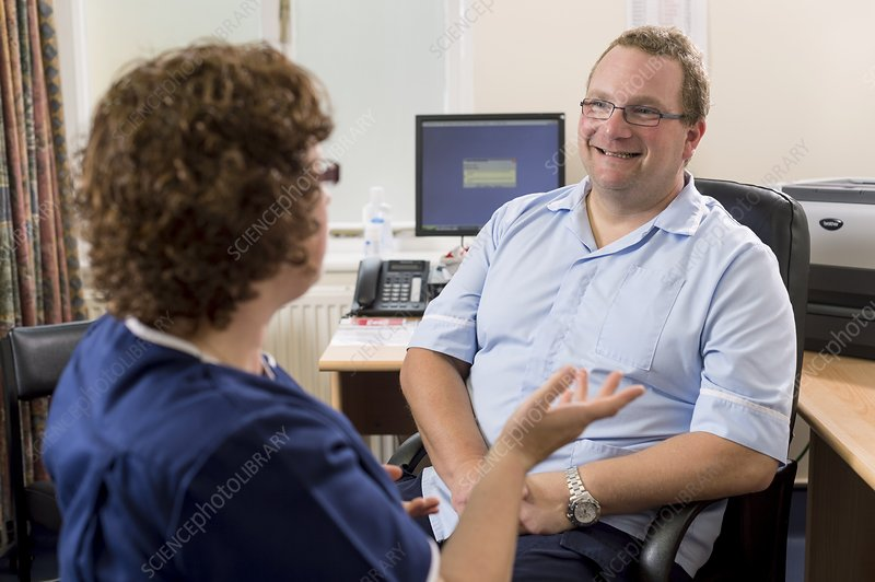 Doctor talking with nurse