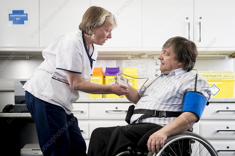 Check up with disabled man