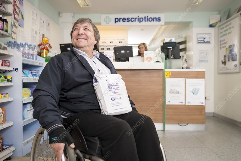 Disabled man in pharmacy