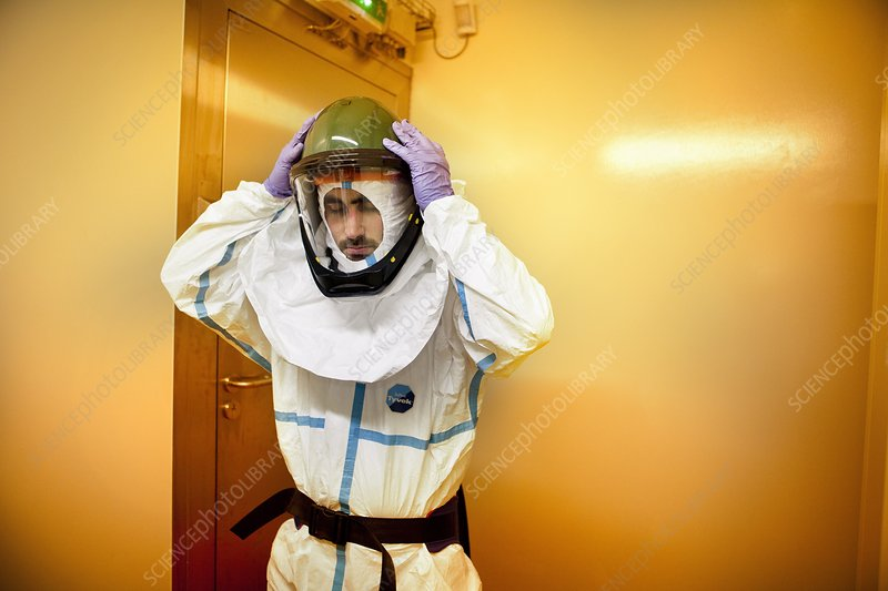 Scientist putting on protective clothing