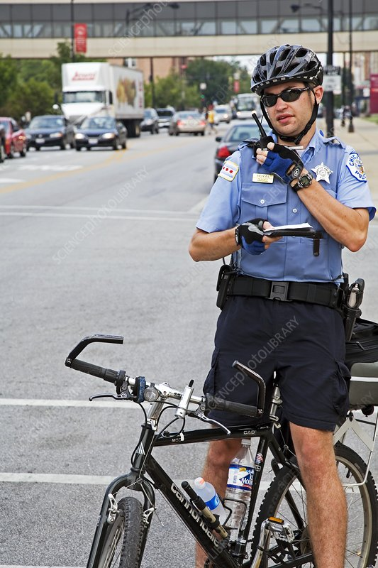 Cycling policeman, Chicago, USA