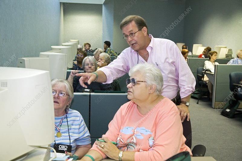 Senior citizens learning to use computers