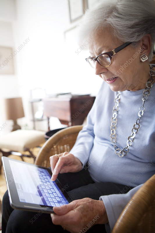 Elderly Person With Tablet