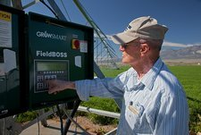 Farmer adjusting irrigation controls