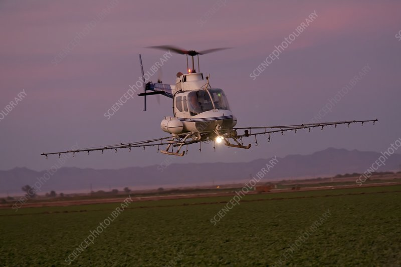 Helicopter spraying pesticides