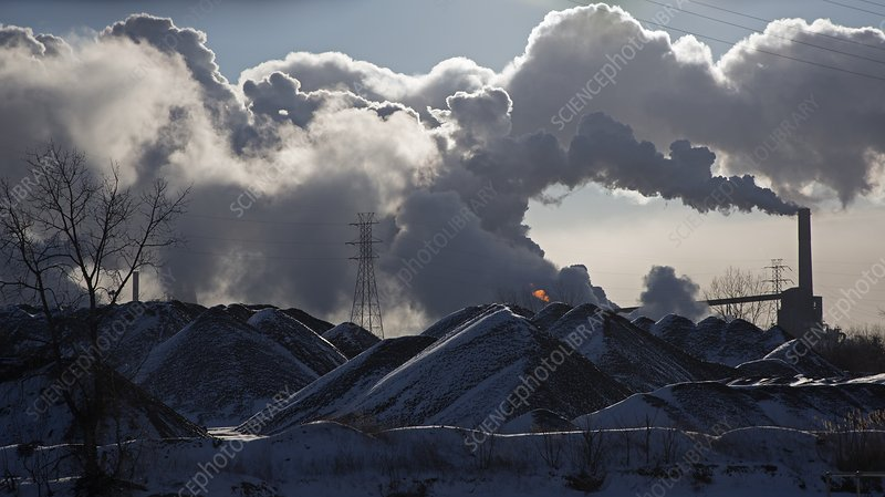 Smoke rising from a steel mill