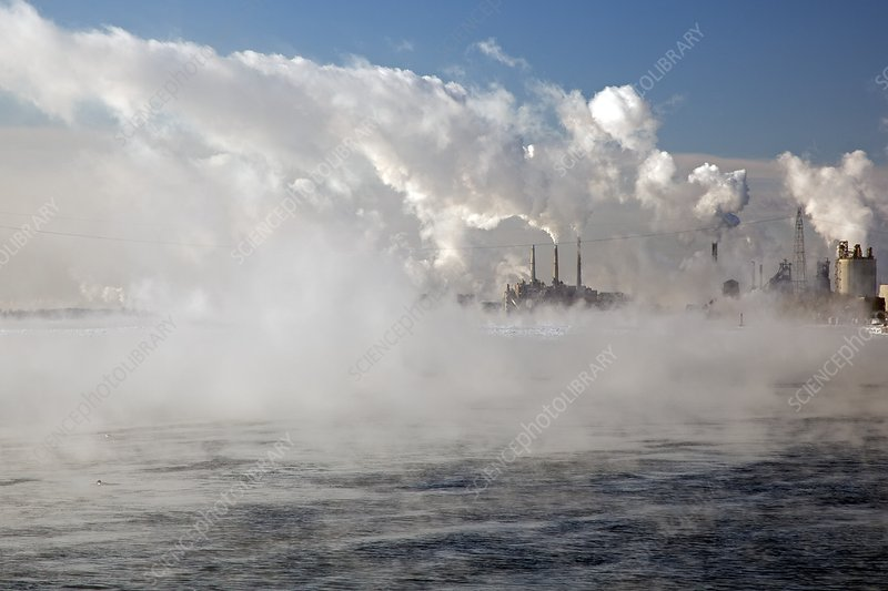 Winter river mist and industry smoke
