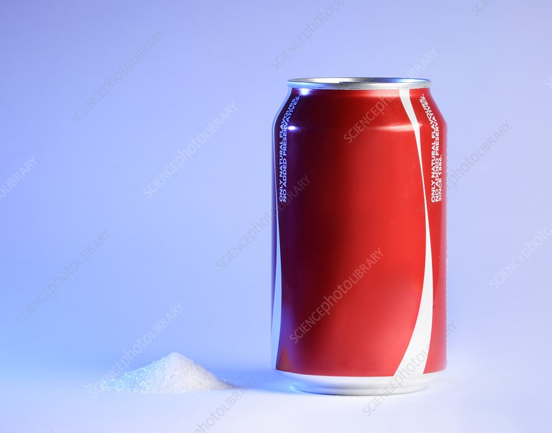 Teaspoon of sugar with can of fizzy drink