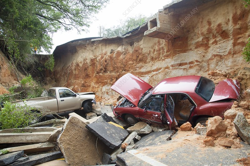 Cars and road washed out by flooding