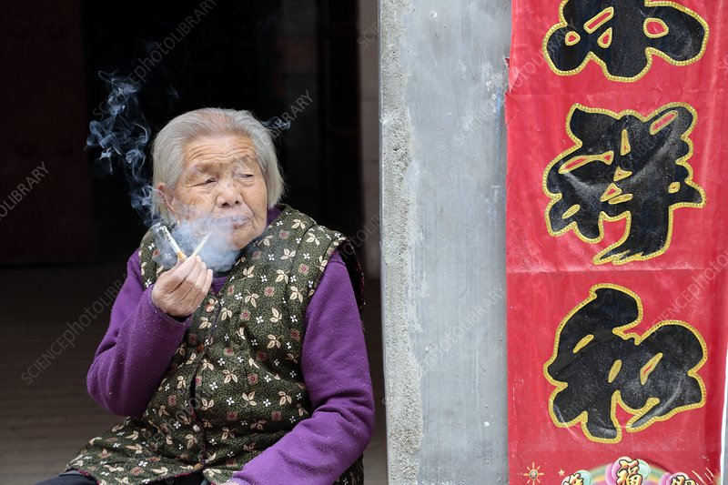 Old lady smoking, China