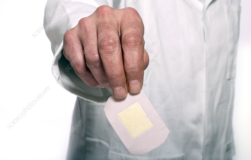 Doctor holding a plaster