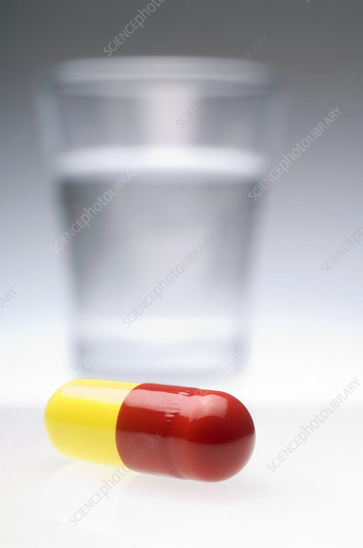 Pill and glass of water