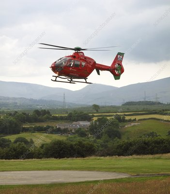 Air ambulance taking off from helipad
