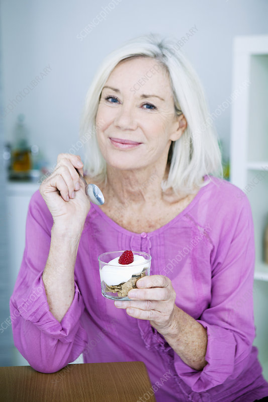 Elderly person snacking