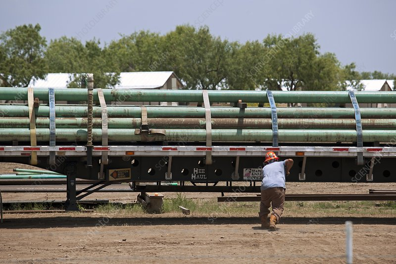 Pipes being loaded on to a truck