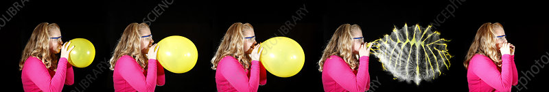 Girl bursting a balloon