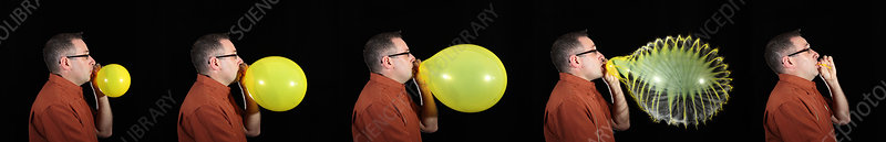 Man bursting a balloon