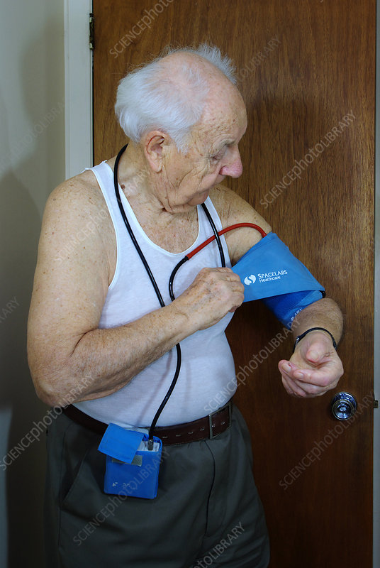 Man Wearing a Blood Pressure Monitor