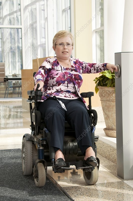 Woman in a motorised wheelchair