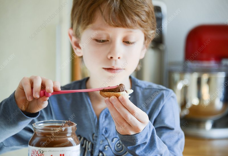 Boy preparing his breakfast