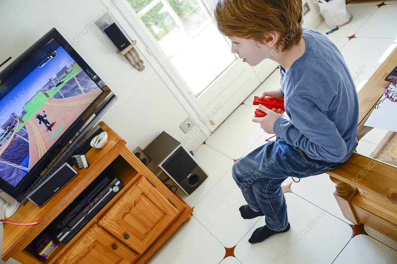 Boy playing Wii video game