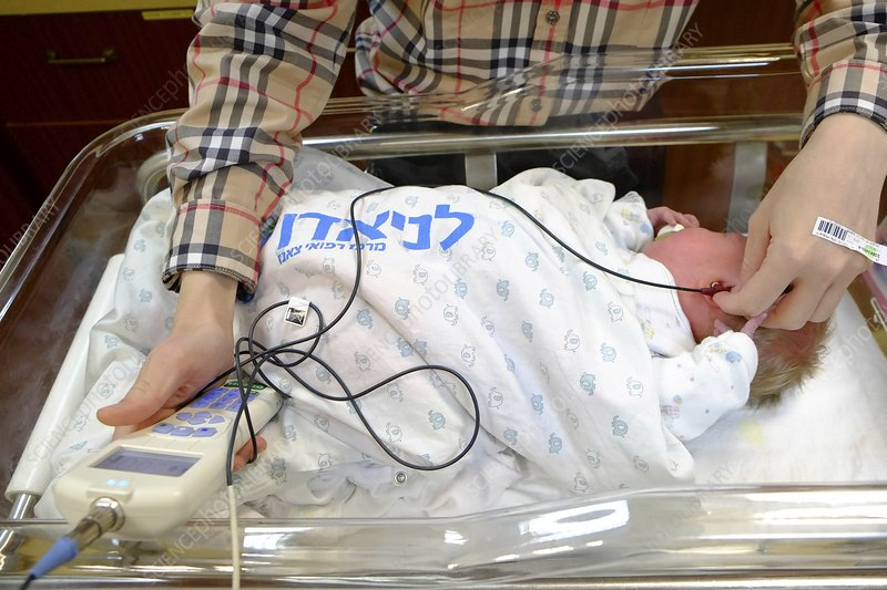 Doctor examines a newborn