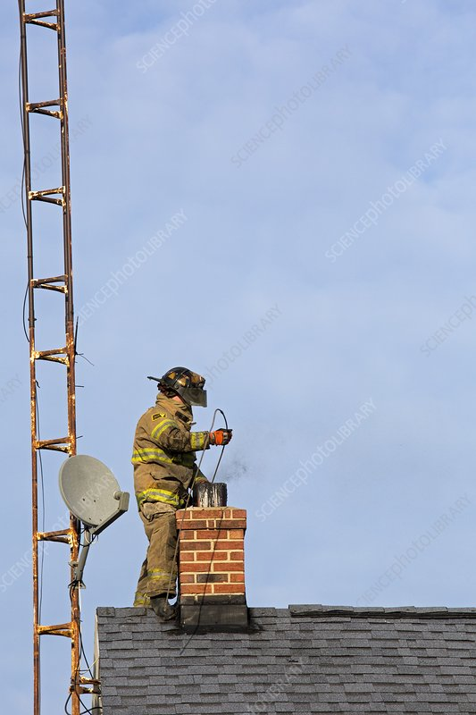 Firefighter fighting a chimney fire