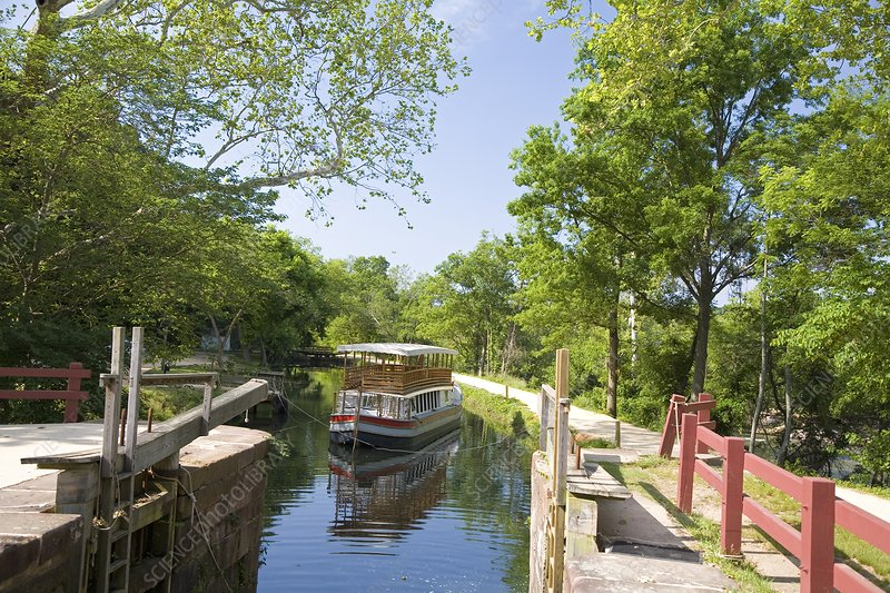 Boat approaching an open canal lock