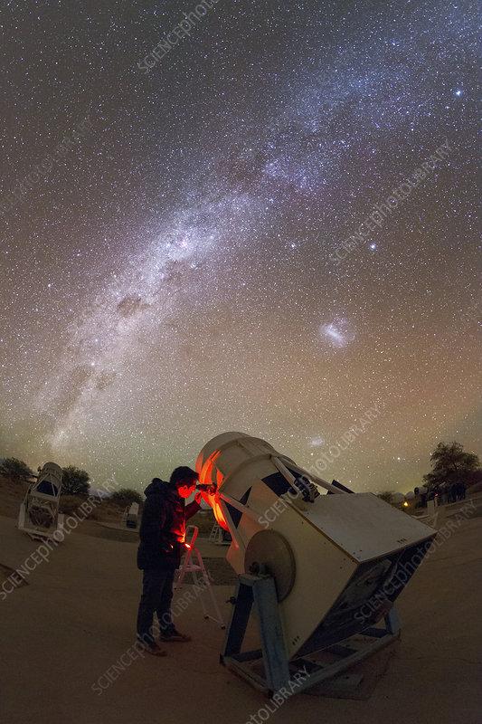 Tourist using a telescope