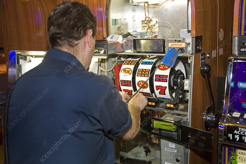 Technician servicing a slot machine