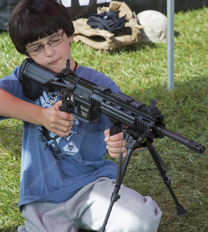 Boy with automatic rifle