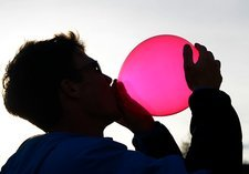 Inhaling nitrous oxide from a balloon