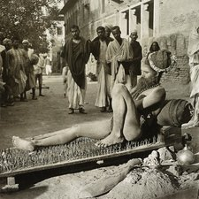 Fakir on his bed of spikes, 1900s