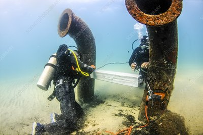 Commercial divers underwater