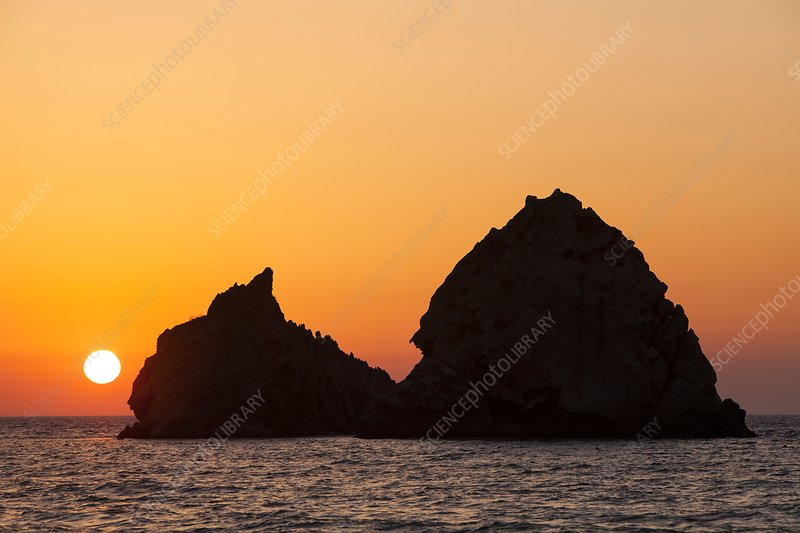 Sunset over rocky islands