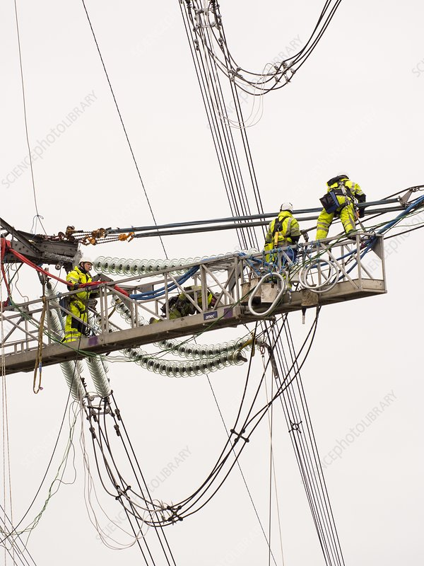 Engineers working on electricity wires
