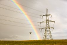 Rainbow over electricity pylons