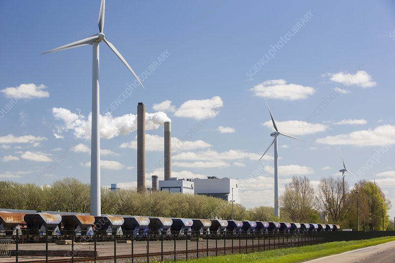 coal fired power station and wind turbine