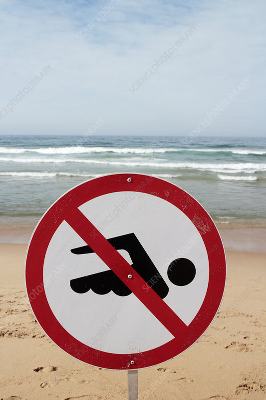 No swimming sign on a beach